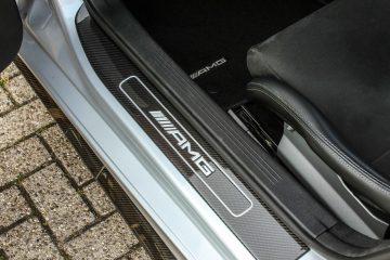 AMG binnekant deur logo